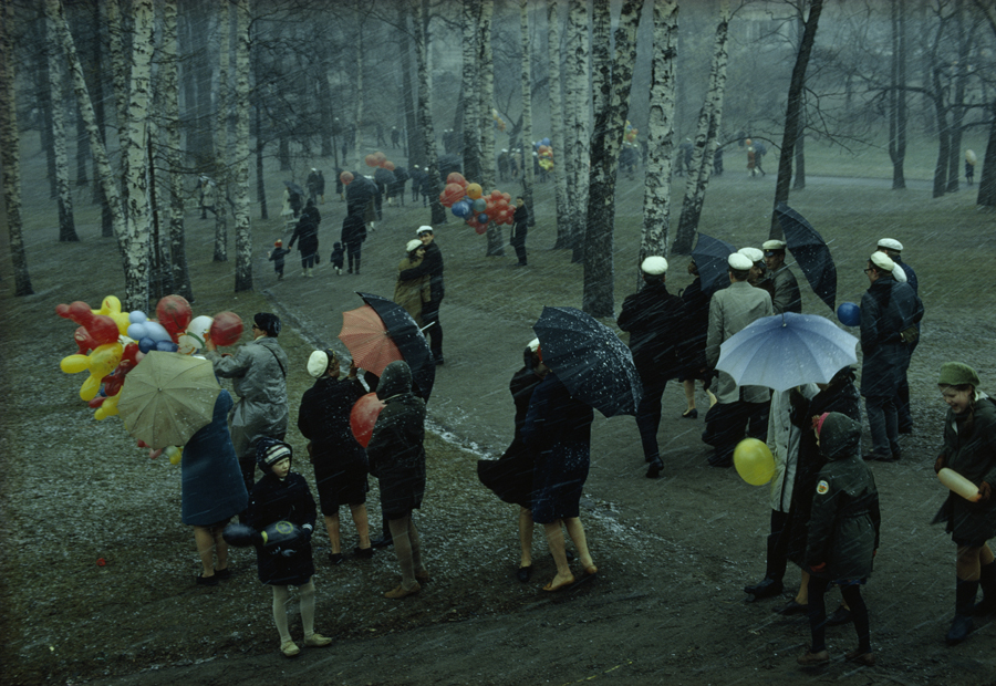 68 People strolling through a park in Finland during a wet May snowstorm, 1968